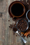 roasted coffee beans and spices on dark wooden background, concept photo, vertical closeup