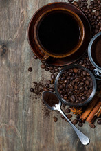 """Постер, картина, фотообои """"roasted coffee beans and spices on dark wooden background, concept photo, vertical closeup"""""""