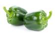 Leinwanddruck Bild - Green pepper on white background
