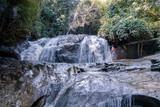 Mae Sa waterfall Chiang Mai Thailand, young man at waterfall