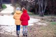 Leinwandbild Motiv Adorable little girls outdoors in the forest