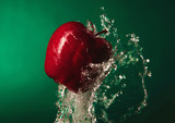 Delicious, fresh apples in splashes of water