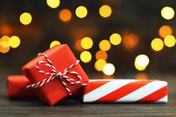 Wrapped Christmas gifts on wooden background