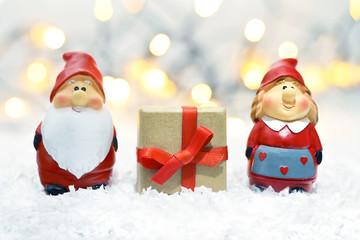 Christmas card. Santa Claus, his wife and Christmas gift