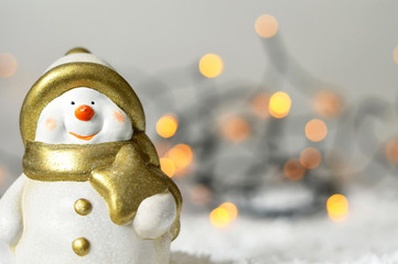 Christmas Snowman figurine and Christmas lights in background
