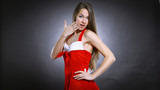 young female model dressed as Santa Claus posing for the camera. - 236841459