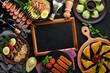 Set Asian food. Noodles, shrimp, Samsa, khinkali. On a black wooden background. Top view. Free copy space.