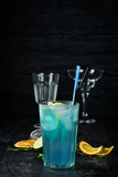 Alcoholic cocktail Blue Lagoon. Drinking On a wooden background. Top view. - 236850441