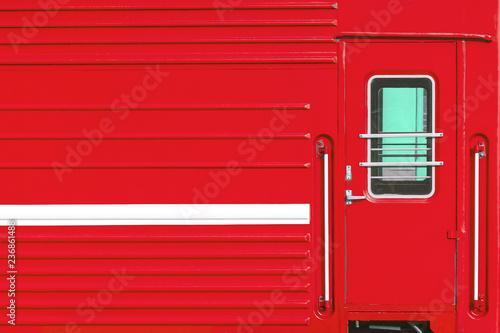 fototapeta na ścianę Window And Door Of The Red Locomotive Wagon.