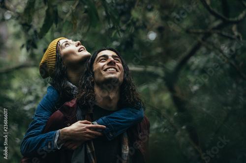 Lovely couple piggybacking in the park under rain - 236866017