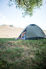 Photo of tent on green lawn on summer