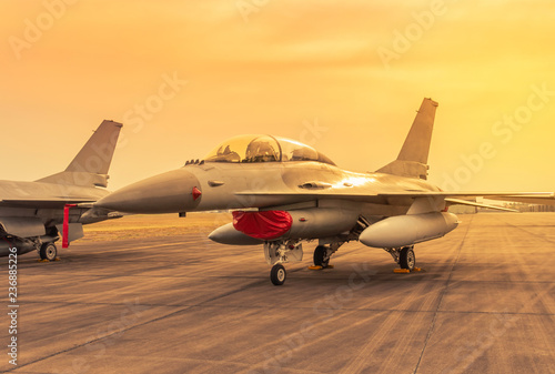 fototapeta na ścianę military fighter jet aircraft parked on runway in the base airforce standby ready to take off for military mission on sunset