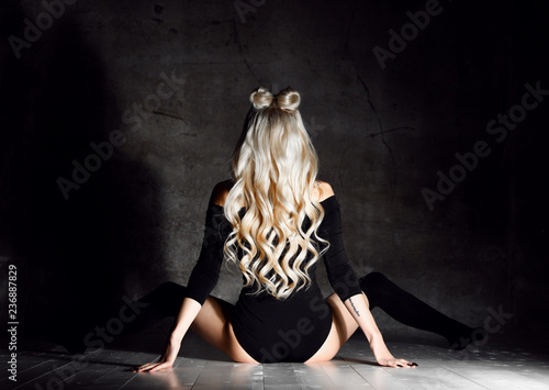 Leinwanddruck Bild Young sexy blonde fashion woman sitting on floor in black body cloth and choker