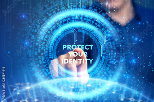 Leinwanddruck Bild Business, Technology, Internet and network concept. Young businessman working on a virtual screen of the future and sees the inscription: Protect your identity