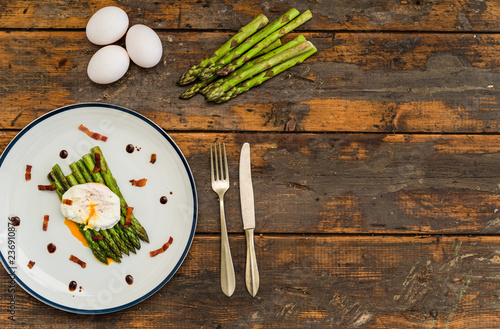 Food photography of a poached egg with asparagus, bacon, crispy bacon, and balsamic vinegar reduction. Breakfast, lunch, brunch, light dinner dish meal, healthy food, and clean eating concept. - 236910876