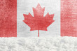 Winter grunge background with snowdrift and Canadian flag in the backdrop