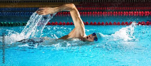 Leinwandbild Motiv Man in swimming pool. Crawl swimming style