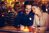 Romantic couple dating in pub at night - 236936020