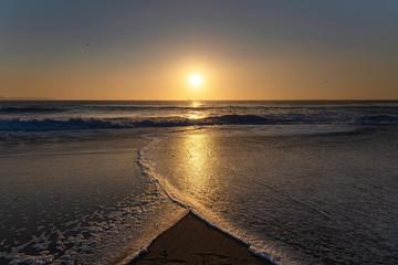 Sunset in Atlantic ocean, Nazare, Portugal. © Janis Smits