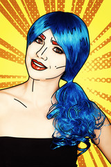 Portrait of young woman in comic pop art make-up style.