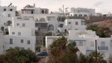 Pan: A Tall Hillside Covered in Picturesque, Whitewashed Buildings - 236958847