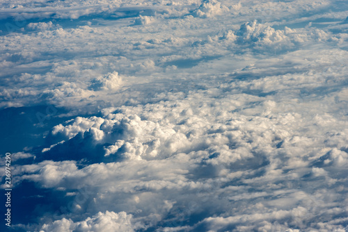 Flying Above the Clouds - View From an Airplane - 236974290