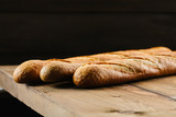 Baguette bread on wooden table