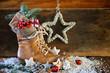 Leinwanddruck Bild - Nikolaus  -  Lederstiefel mit Geschenken vor Holz Hintergrund