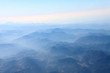 mountain view from above through the clouds - 236984890