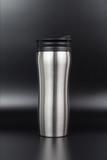 Metal thermos on black background, travel mug - 236992291