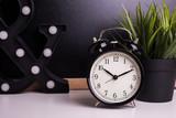 vintage alarm clock on the background of a blackboard - 236996458