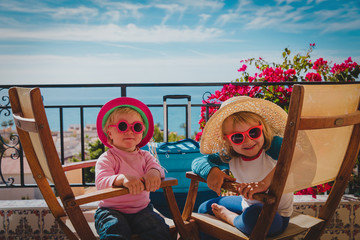 happy littlel girls love travel enjoy vacation near the beach