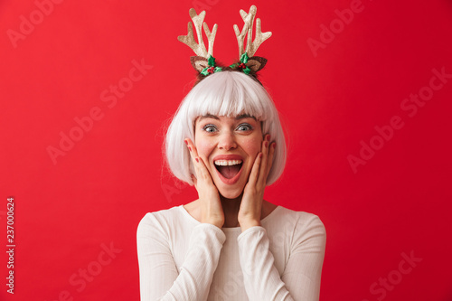 Pretty young girl wearing Christmas deer horns