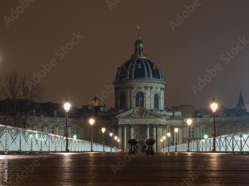River Seine with Pont des Arts and Institut de France in Paris France