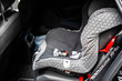Child safety seat in the back of the car. Baby car seat for safety. Car interior. Car detailing. Child safety concept