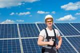 Solar panels engineer in white cask - 237012207