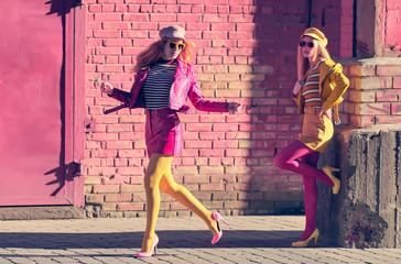 Two woman walking in urban street. Having Fun