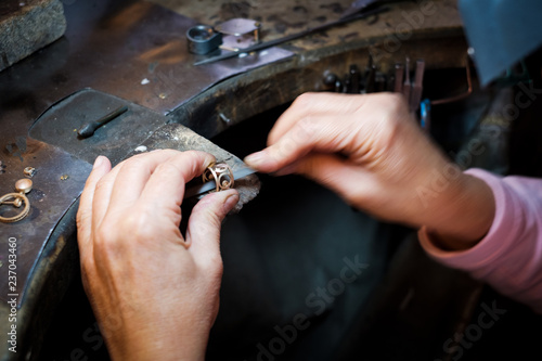 Jeweler working with needle file gold ring  in jewellery workshop © photoflorenzo