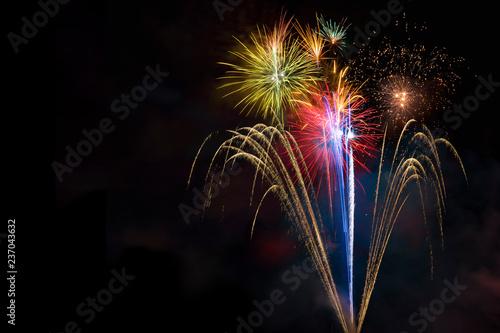 Leinwanddruck Bild Fireworks display over dark sky