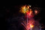 Fireworks display over dark sky