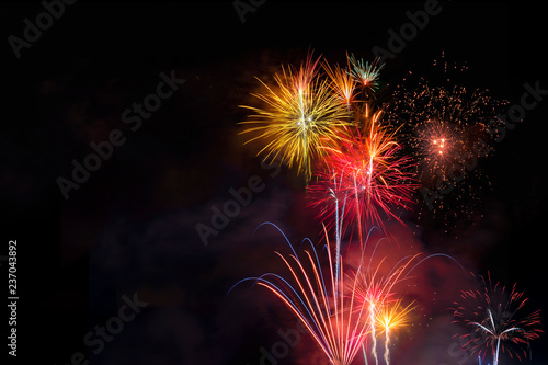 Fireworks display over dark sky - 237043892