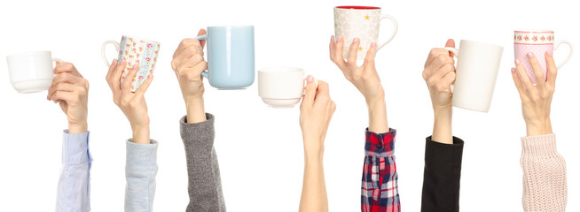 Many different arms hands raised up holding cup mug on white background isolation © evgenyjs1