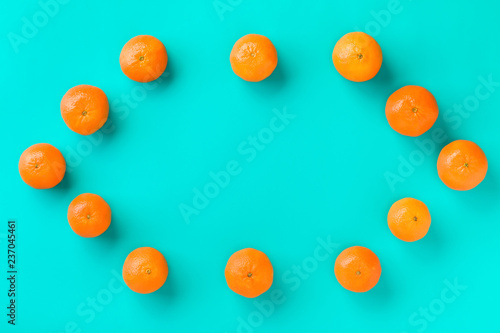 Fruit pattern of mandarin isolated on blue background. Tangerine. Flat lay, top view. - 237045461