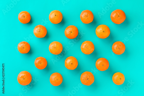 Fruit pattern of mandarin isolated on blue background. Tangerine. Flat lay, top view. - 237045471