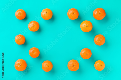 Fruit pattern of mandarin isolated on blue background. Tangerine. Flat lay, top view. - 237045488