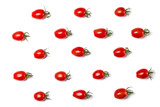 Food pattern of cherry tomato isolated on yellow background. Flat lay, top view.