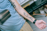 Fit young guy having new tattoo on inner side of his lower hand - 237049213