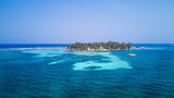 Aerial drone view of Tobacco Caye small Caribbean island with palm trees and bungalows in the Belize Barrier Reef - 237049607