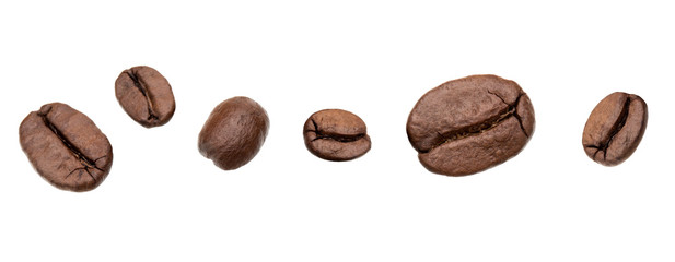 roasted coffee beans isolated in white background cutout. Line arrangement. © Natika