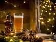 Leinwanddruck Bild - Beer in glass on wooden background with Christmas lights and pine cones